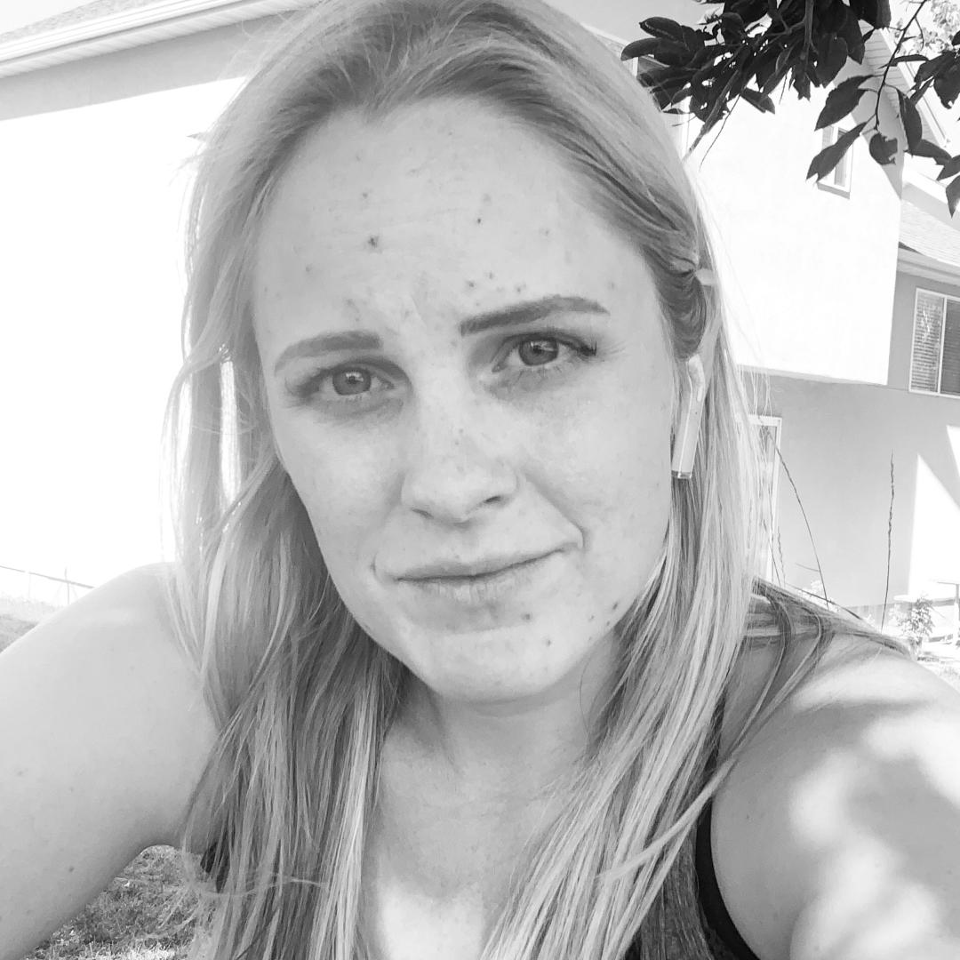 Black and white close up of stoic-faced Laura Cragun